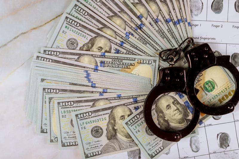Police handcuff in the arrest corruption and money U.S. dollars banknotes and criminal investigation fingerprint record stock photos