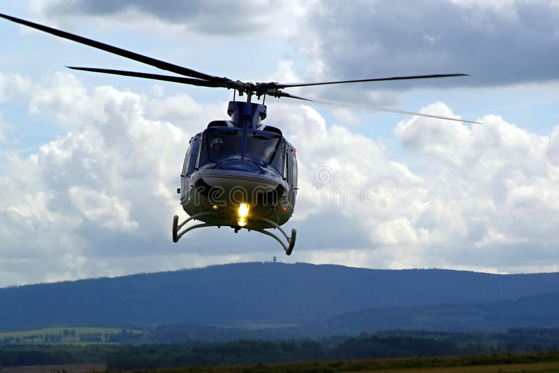Police helicopter in flight royalty free stock image