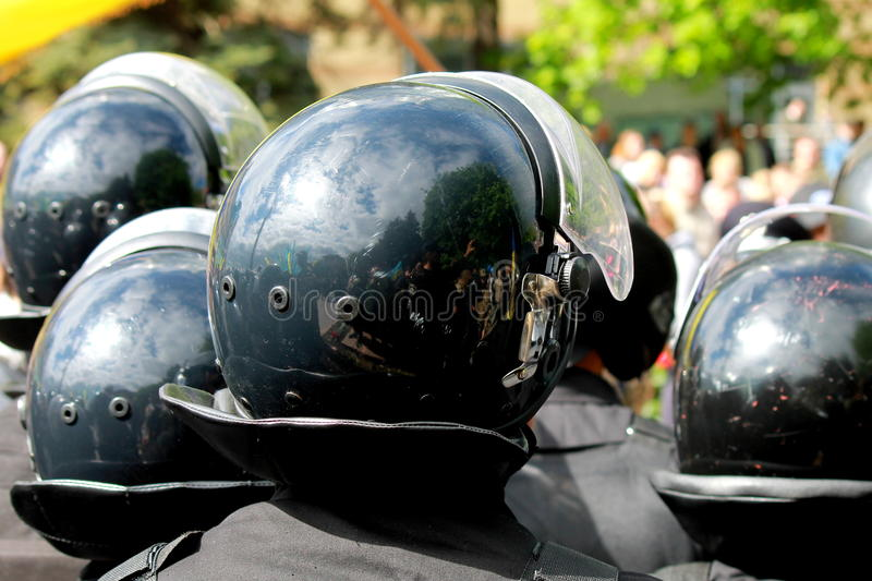 Police in helmets are guarding the rule of law at demonstrations stock photography