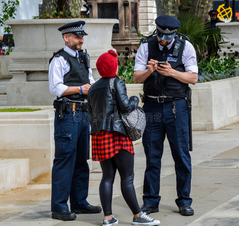 Free Police Helping A Pedestrian Royalty Free Stock Photography - 65549257