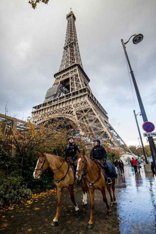 Police on horse near the Eiffel Tower stock image