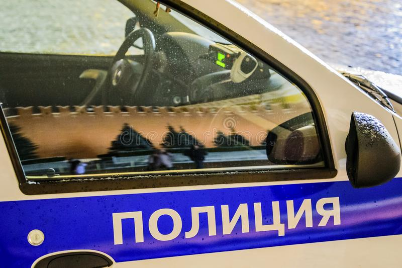 `Police` - the inscription on the official car. Russia. Translation of the text into English-`Police. `Police` - the inscription on the official car. Russia royalty free stock images