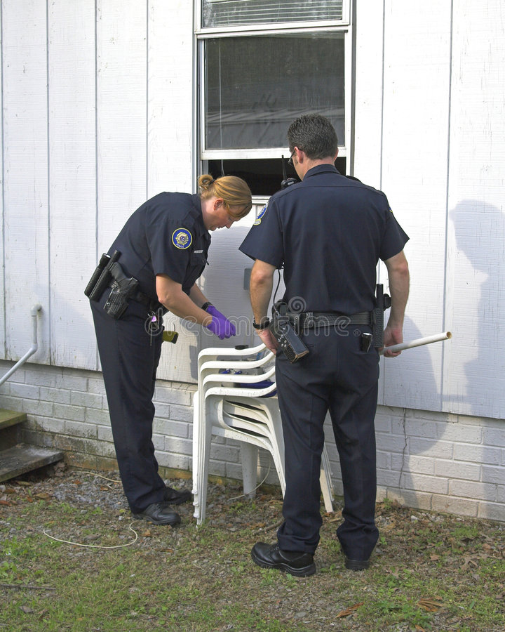 Download Police Investigating Burglary Royalty Free Stock Image - Image: 2381116