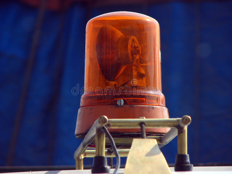 Police Light. A rotating siren light on an Indian police car stock photo