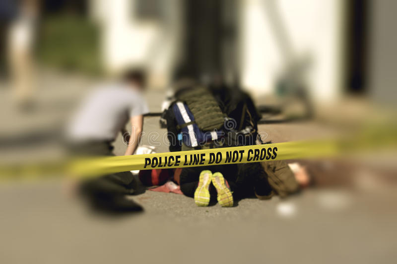 Police line with blurred medic law enforcement background stock images