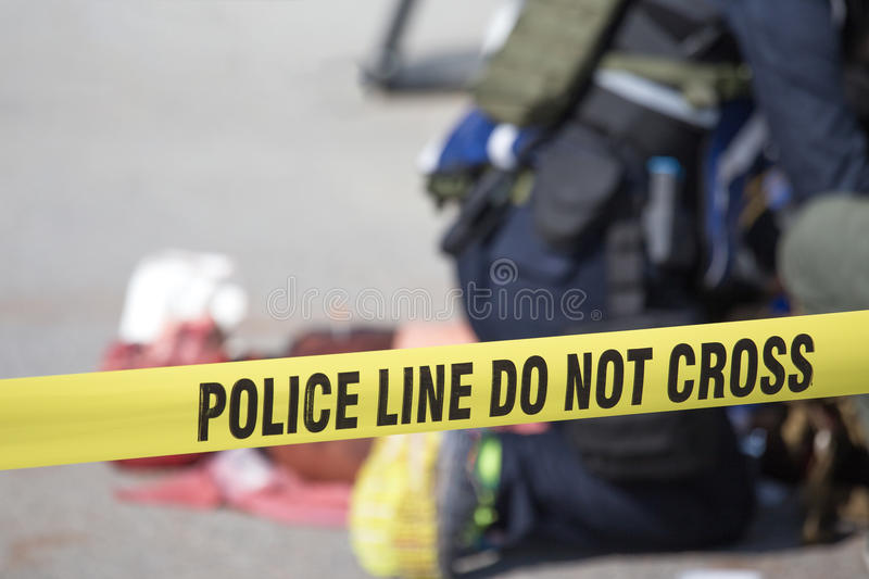 Police line do no cross with blurred medic law enforcement background. In medical evacuation training with copy space royalty free stock photography
