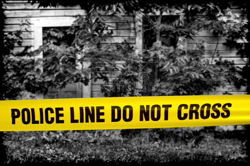 Police Line Do Not Cross Tape at Crime Scene House royalty free stock photography