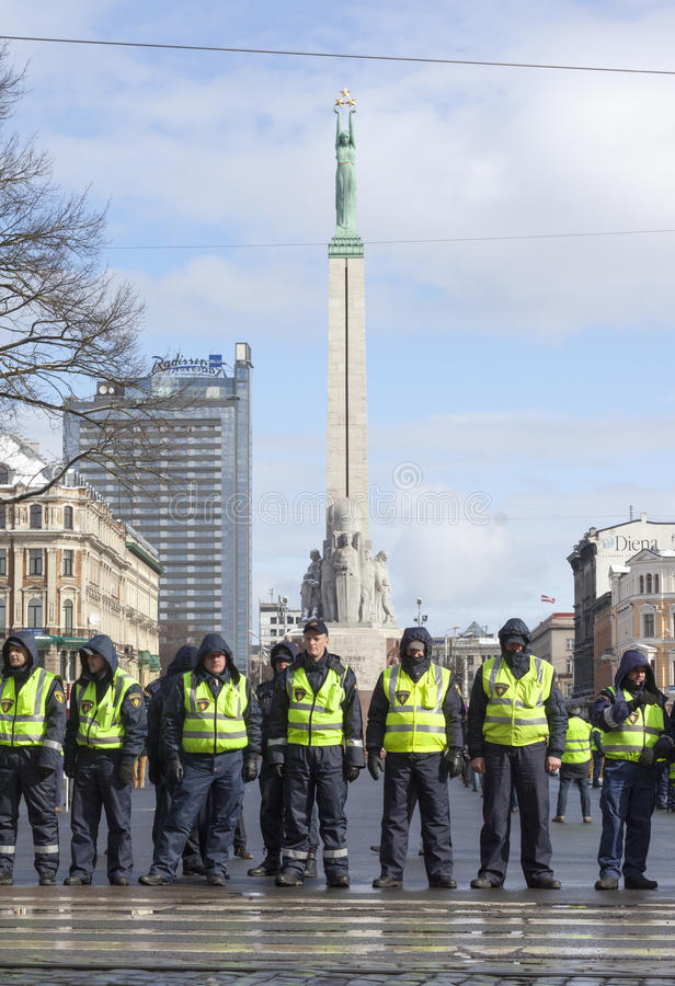 Police line infront Freedom Monument in Riga, Latvia royalty free stock photo