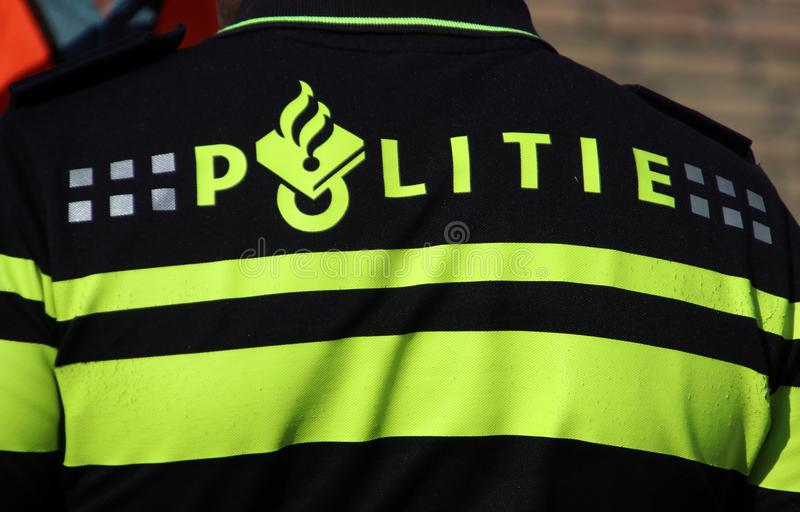 Police logo on the back of an agent on the uniform in the Netherlands stock image