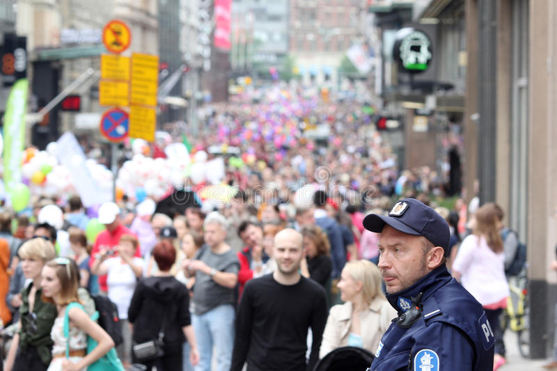 Police man looks to the gay parade royalty free stock photography