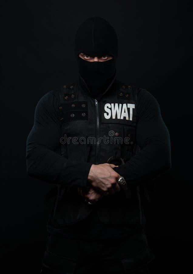Police man swat. Male model in police unigorm stock image
