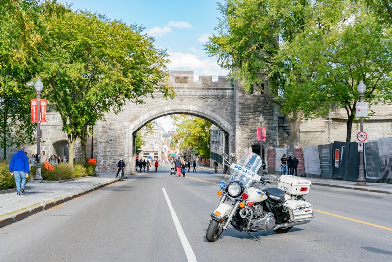 Police motor block the road in front of the old Porte Saint-Louis wall. Quebec, OCT 3: Police motor block the road in front of the old Porte Saint-Louis wall on stock image