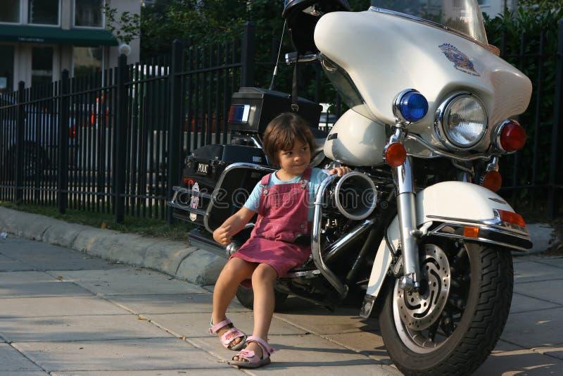 Police motorbike. Child sits on police motorbike stock images