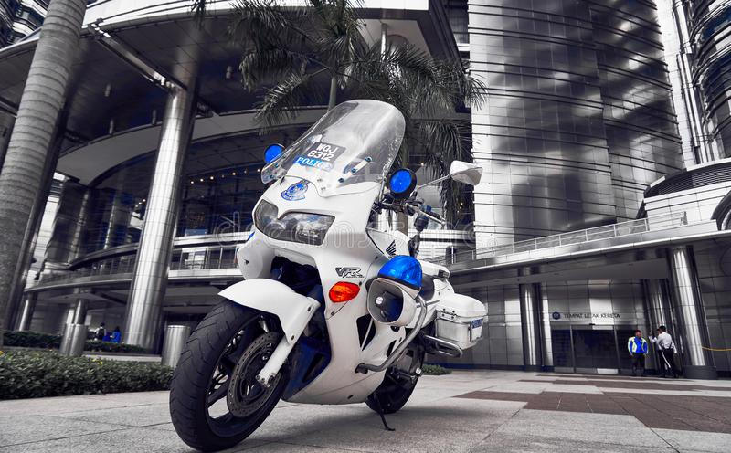 Police motorbike standing in front of Petronas Twin Tower lobby royalty free stock photo
