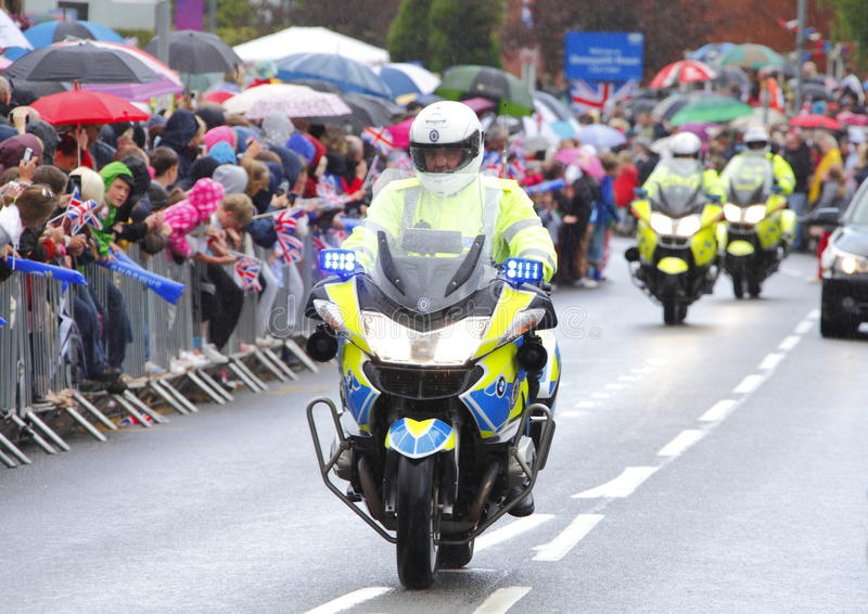 Police motorbikes. And officers on patrol as the Olympic torch passes through Great Wyrley, West Midlands, UK on Saturday 30th June 2012 royalty free stock images
