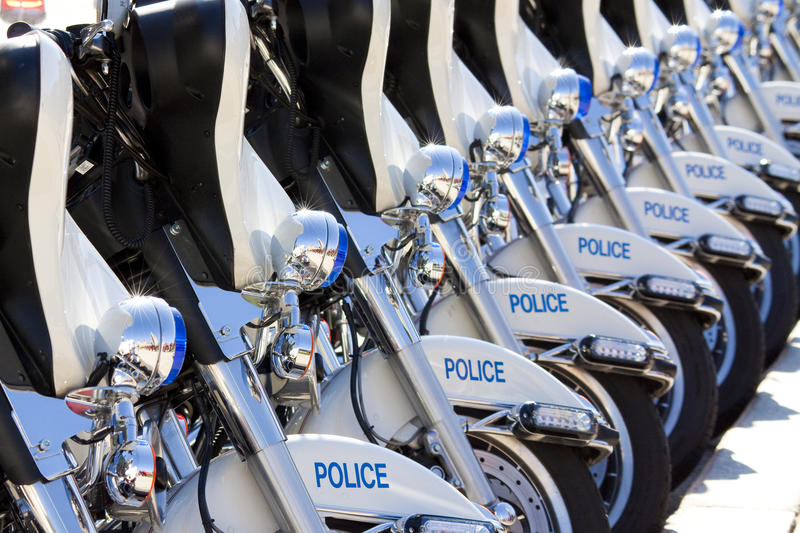 Police motorbikes aligned. Motorbikes of police alligned along the board of the square royalty free stock images