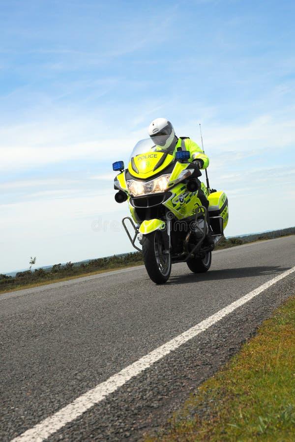 Police bike against blue sky stock photography