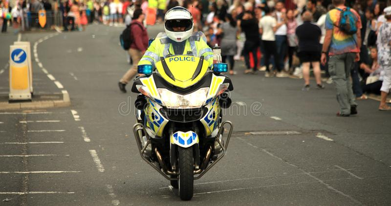 Police motorcycle closing off road, public safety, major incident royalty free stock photography