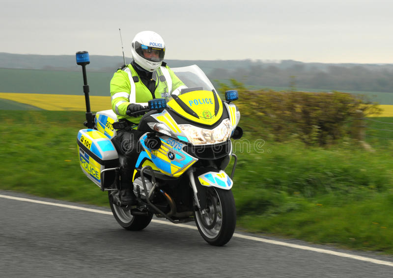 Police motorcycle officer at speed royalty free stock photos