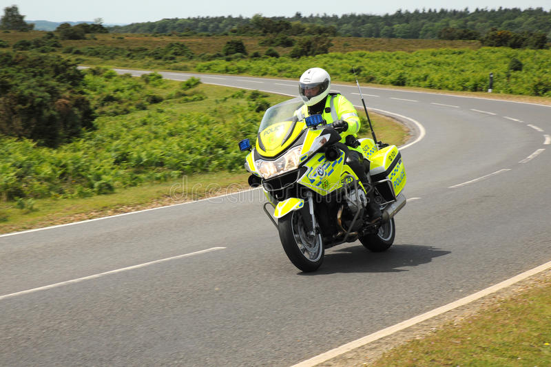 Police motorcycle on a twisting country road stock image