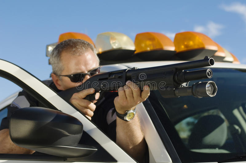 Police Officer Aiming Shotgun royalty free stock image