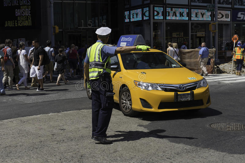 Police Officer Directs Midtown Traffic royalty free stock images