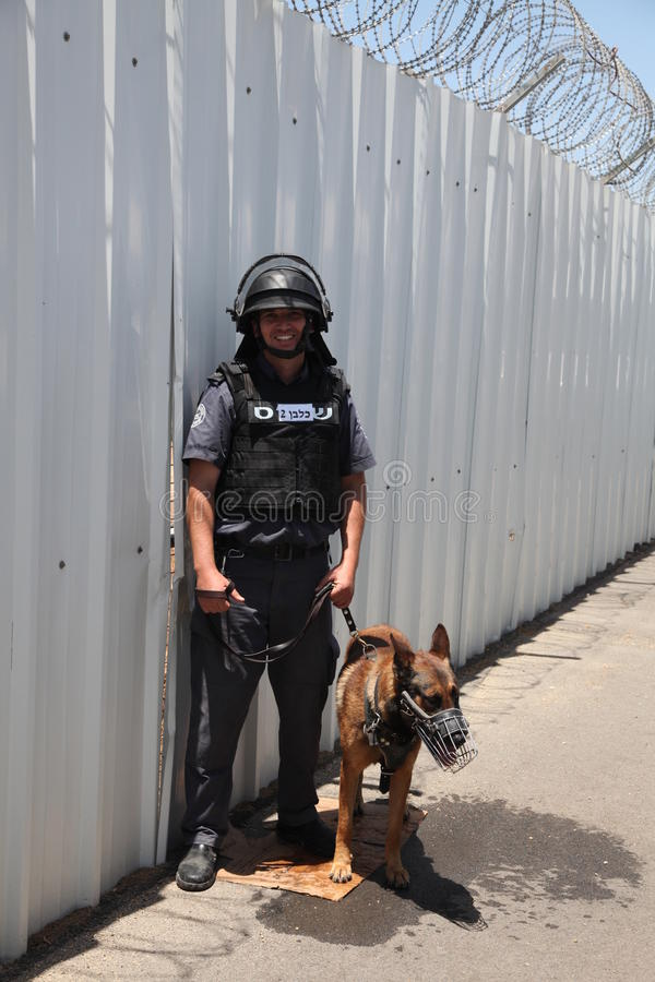 Police officer dog trainer at Carmel Prison stock photography