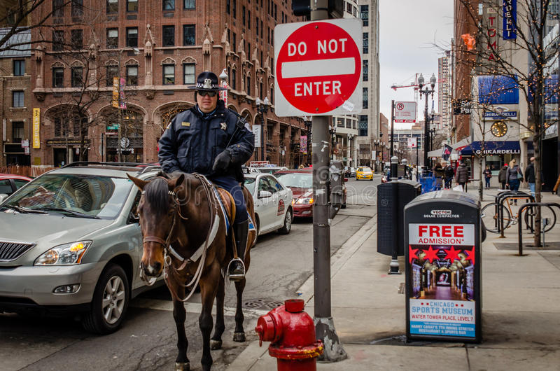A police officer is on duty in downtown Chicago stock photos