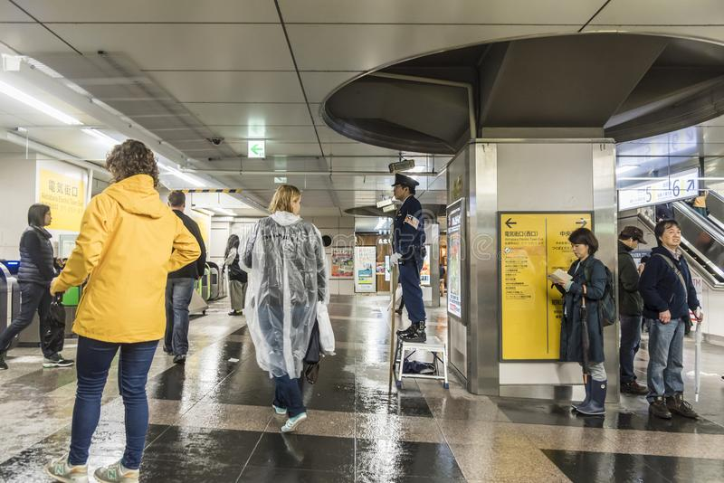 Police officer guarding Akihabara railway station Tokyo stock images