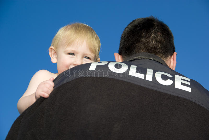 Police Officer Holds Baby stock image