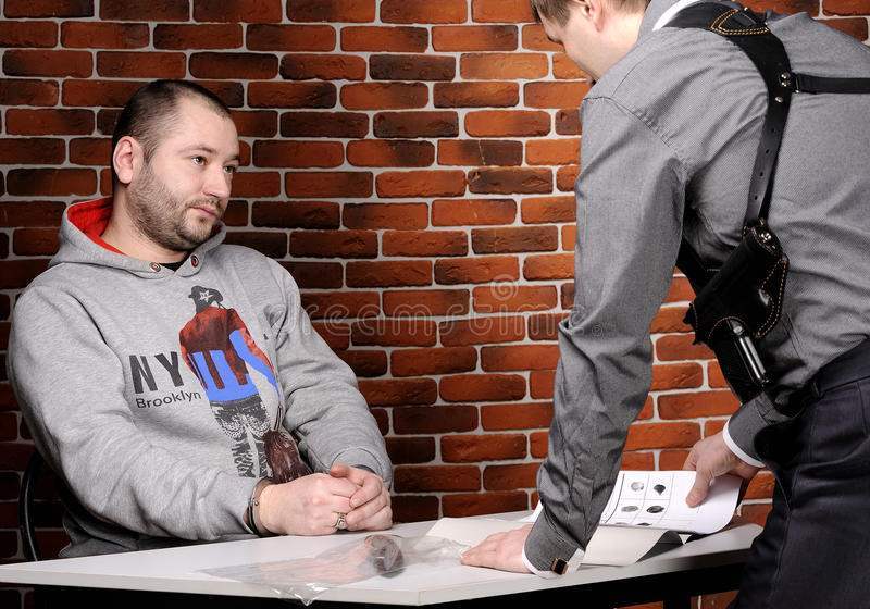 Download Police Officer Interrogates Detainee Royalty Free Stock Photography - Image: 23576007