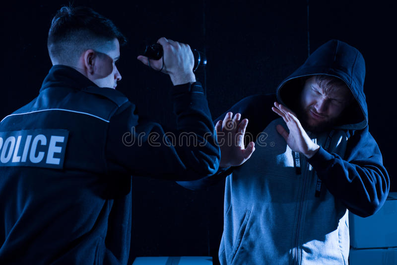 Police officer and lawbreaker royalty free stock images