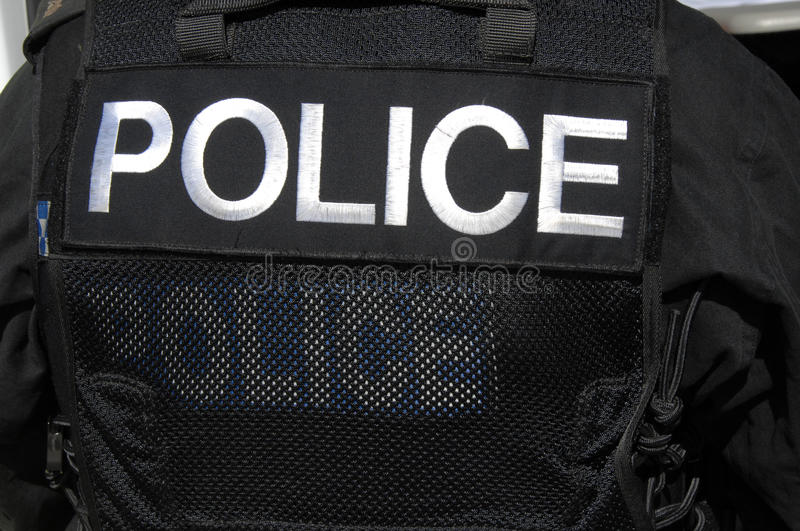 POLICE officer logo on SWAT officers vest. stock photos