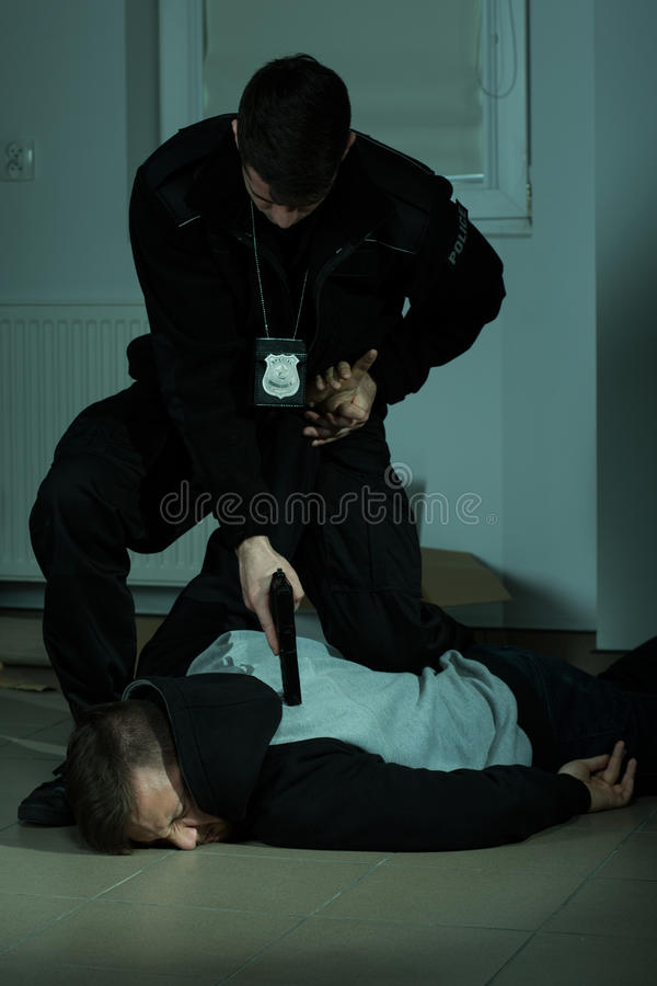 Police officer overpowering a criminal royalty free stock photography