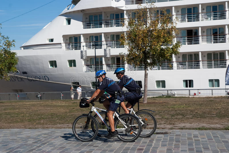 Police officer patrol on a bike royalty free stock photos