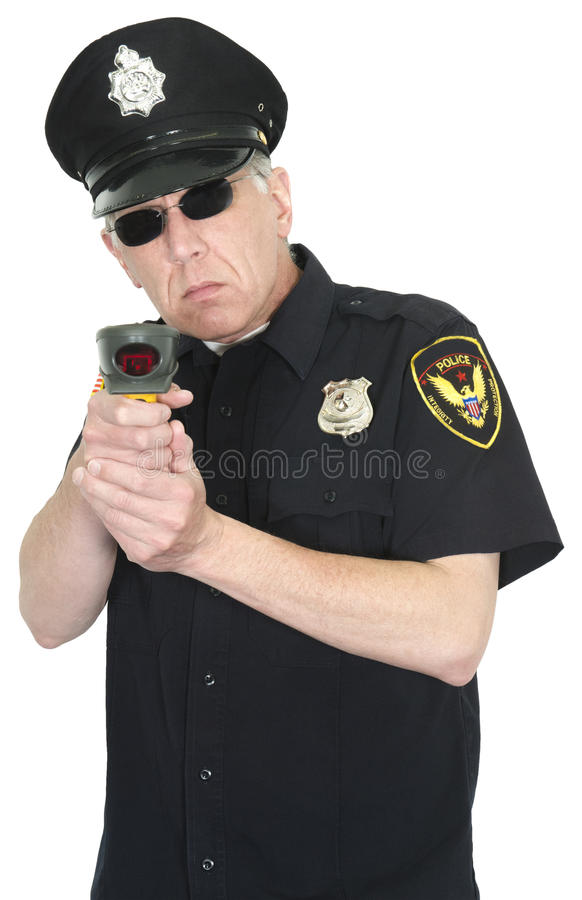 Police Officer, Radar Gun, Speed Trap, Isolated. A police officer or policeman is holding a radar gun and is setting up a speed trap for drivers who are speeders stock photos