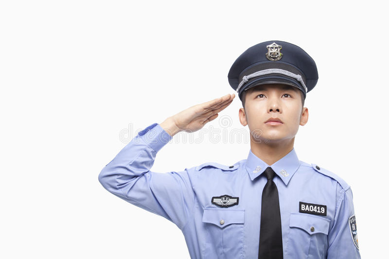 Police Officer Saluting, Studio Shot stock image