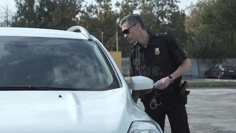 Police officer stopping the driver of a vehicle royalty free stock photos