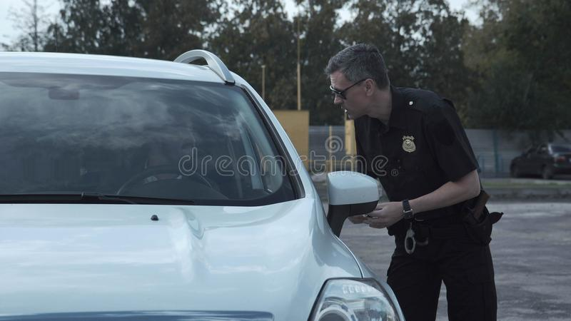 Police officer stopping the driver of a vehicle stock photo