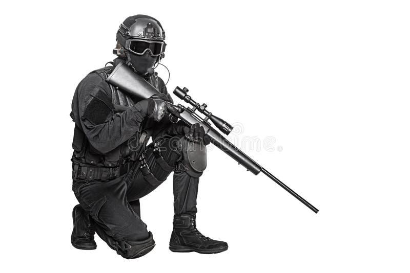 Police officer SWAT. Spec ops police officer SWAT in black uniform and face mask studio shot royalty free stock image