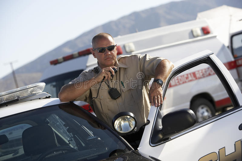 Police Officer Using Two Way Radio stock images
