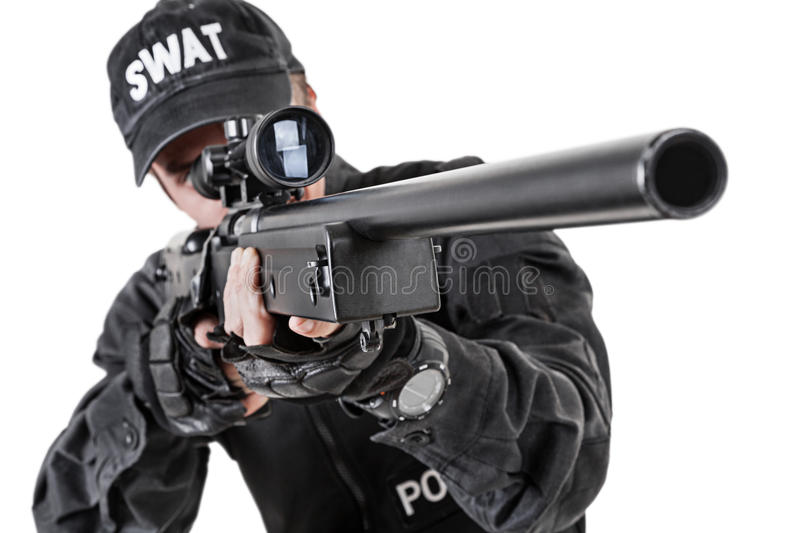 Police officer with weapons. Spec ops police officer SWAT in black uniform studio royalty free stock image