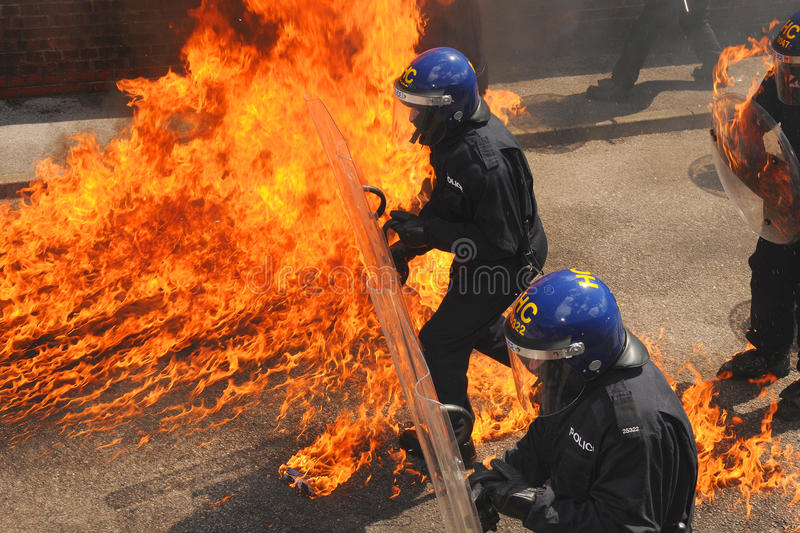 Police officers into the fire royalty free stock photo