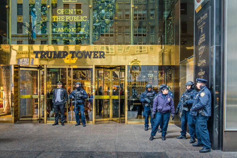 Police officers in front of the Trump Tower, residence of president elect Donald Trump - New York, USA. New York, USA - December 09, 2016: Police officers in royalty free stock photo