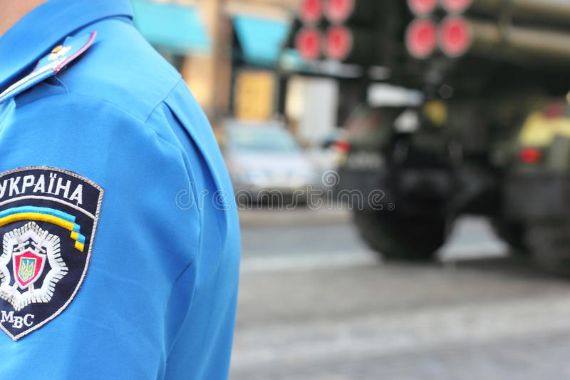 Police officers on guard of law and order. Police patrol the streets of Ukraine during the passage through the city Kiev military equipment. parade dedicated to stock photo