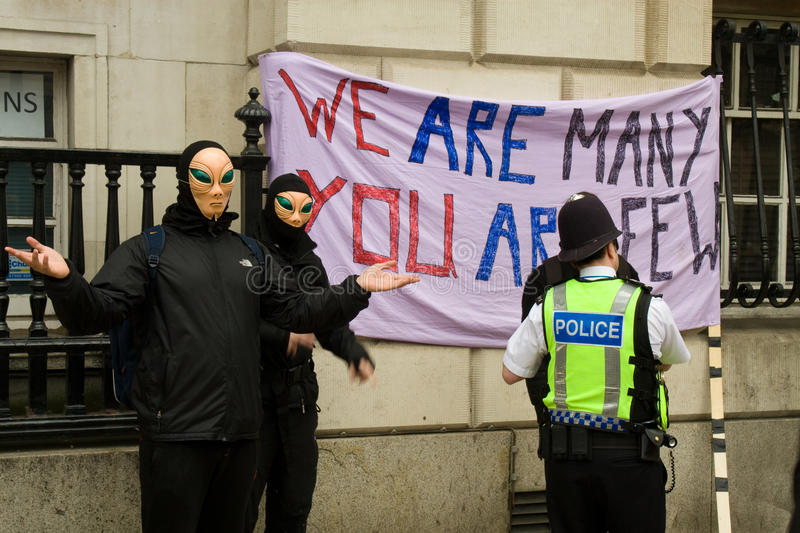 Police officers question  alien  marchers