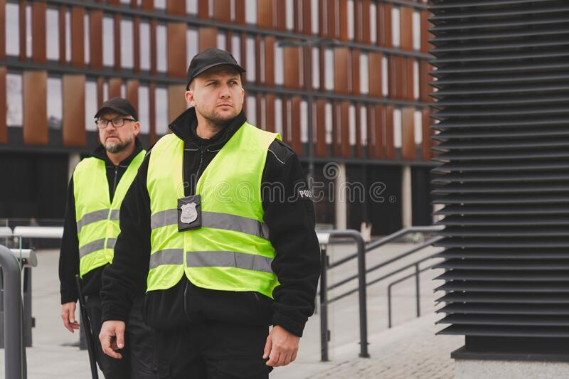 Police officers responding to emergency calls in th town stock photography