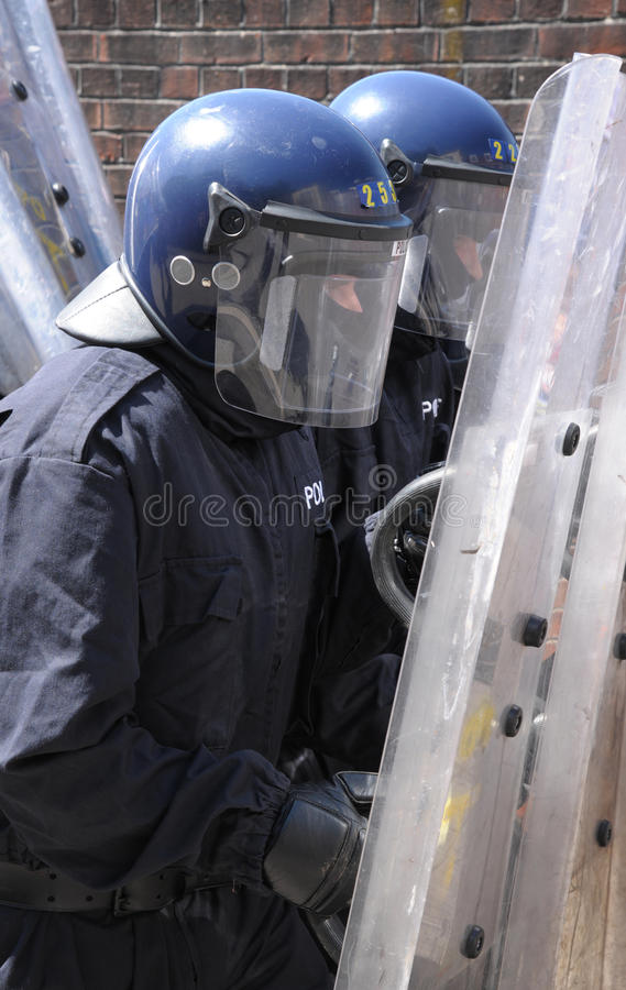 Police officers with shields stock image