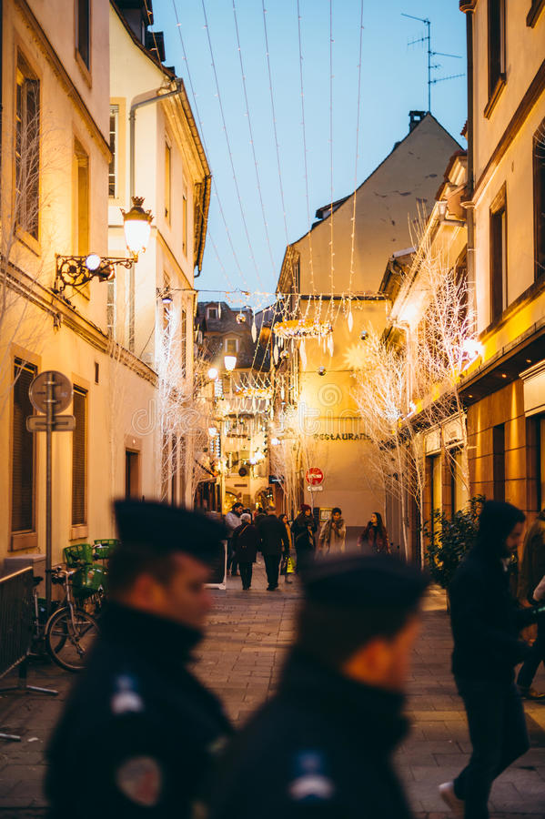 Police officers silhouette surveillance Christmas Market stock photos