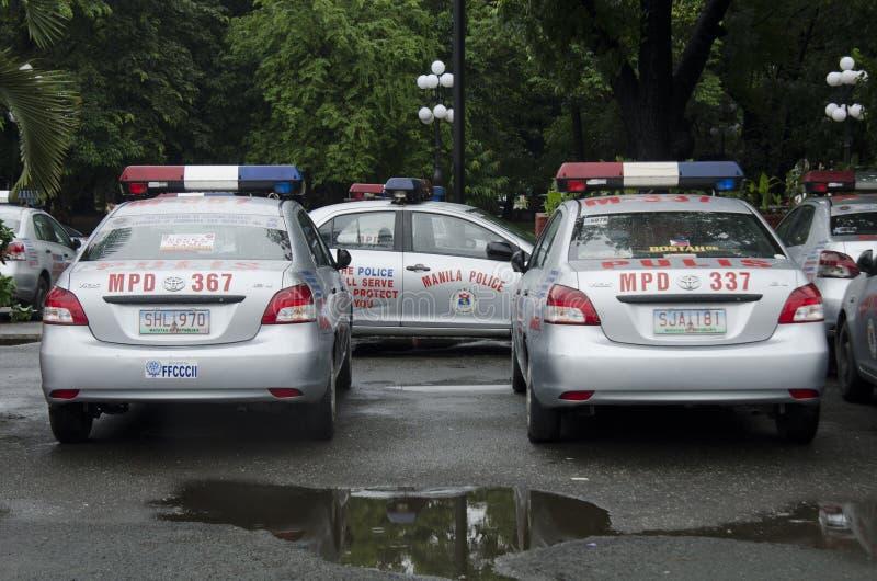 Police partol car. Metro Manila, Police cars parked near a station in central Manila stock photos